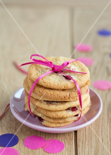 A stack of strawberry cookies tied with a ribbon