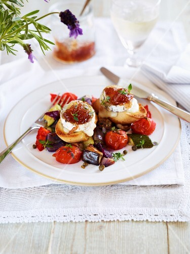 Goats cheese with chutney on roasted vegetables