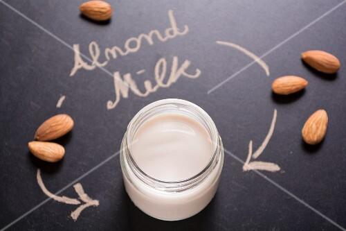 Almond milk in a screw-top jar on a blackboard