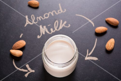 Almond milk in a screw-top jar on a blackboard