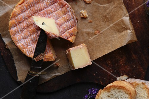 Livarot cheese with a slice cut out (seen from above)