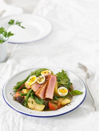 Salad Niçoise with fried tuna fish and soft-boiled eggs