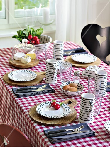 A table laid for supper with cheese, radishes and hard-boiled eggs