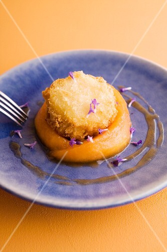 Goat's cheese tempura with lavender on melon confit