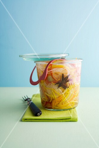 Pickled vegetables with star anise in a flip-top jar