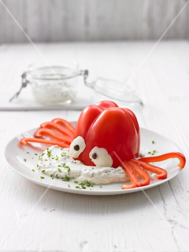 A vegetable octopus with a dip