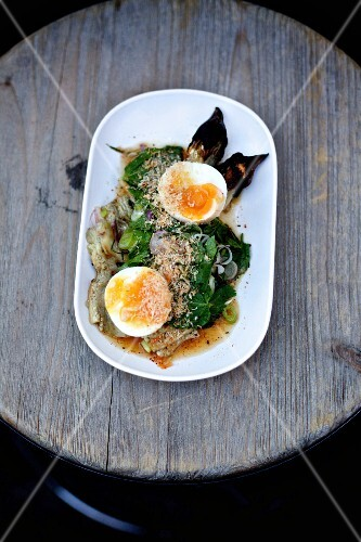 Thai aubergines with spinach, Thai herbs, coconut crunch and soft-boiled egg