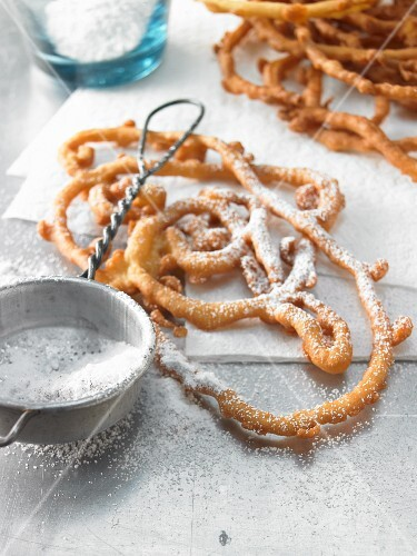 Freiburger Striebele (deep fried pastries) with icing sugar