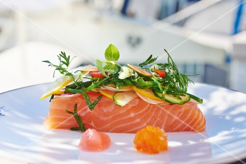 Raw salmon fillet with vegetable bouquet
