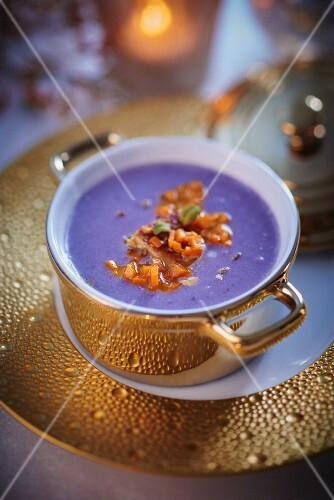 Truffle potato soup in a golden cup