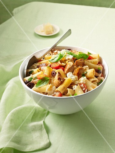 Pasta with turkey, olives, tomatoes and sheep's cheese