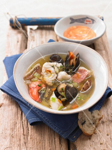 Bouillabaisse (yellow fish stocked with fish fillets and lobster)