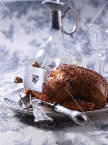 A roast chicken wearing cufflinks
