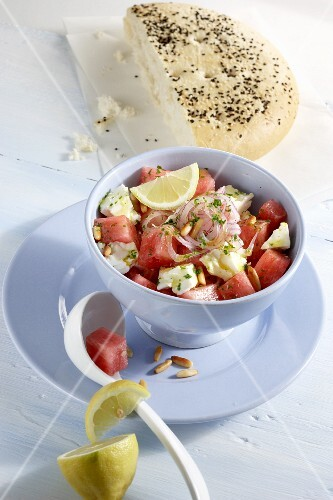Watermelon salad with feta cheese and onions