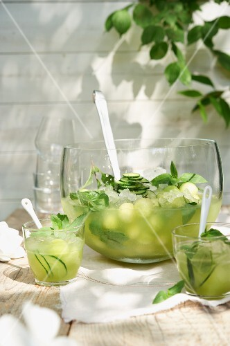 Melon punch with cucumber on a table outside