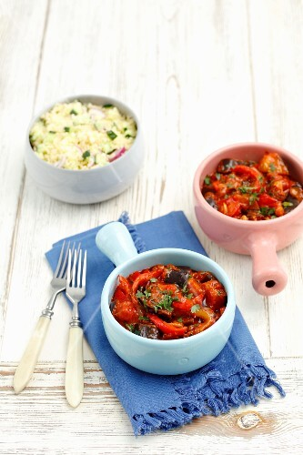 Aubergines and peppers with raisins braised in a tomato sauce served with couscous