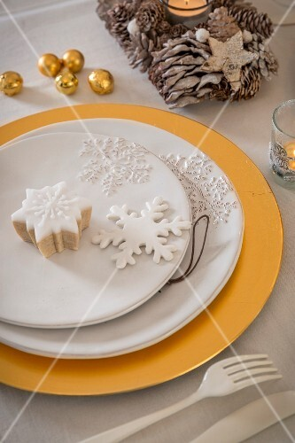 Snowflake ornaments on plate on gold charger plate