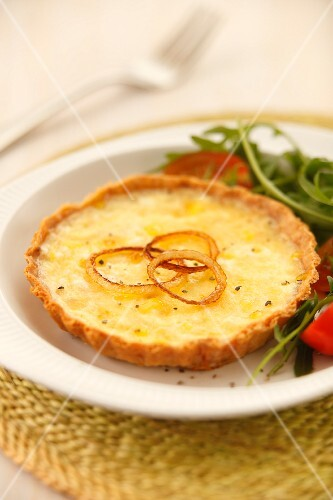 Cheese and onion quiche with a side salad