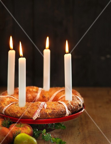 A Christmas advent wreath cake with candles
