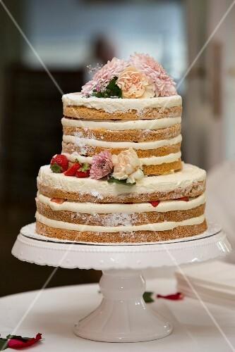 Naked cake – a layered wedding cake with mascarpone cream and strawberries