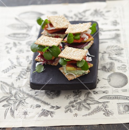 A cracker sandwich with watercress, pears and beetroot