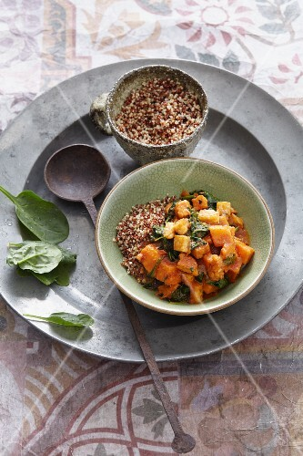 Fried vegan sweet potatoes with tempeh and quinoa