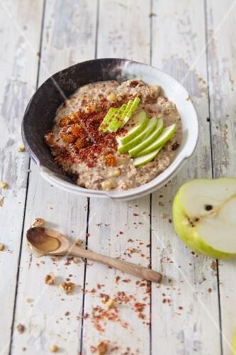 Vegan nut flake muesli with pears and goji berries
