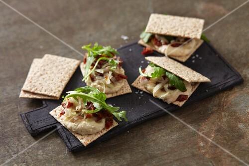 Cracker sandwiches with vegan cashew cheese cream and fresh kohlrabi