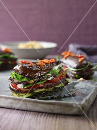 Stacks of aubergines, tomatoes, courgettes and lettuce (Belgium)