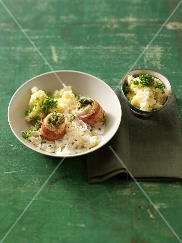 Plaice rolls wrapped in bacon served with sauerkraut and mashed potatoes