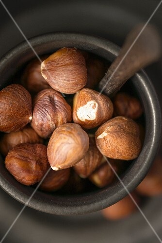 Hazelnuts in a porcelain cup