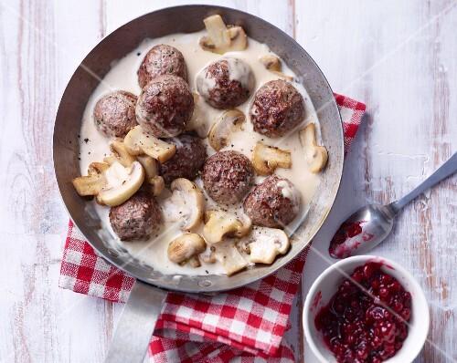 Köttbullar (Swedish meatballs) with a creamy mushroom sauce and lingonberries