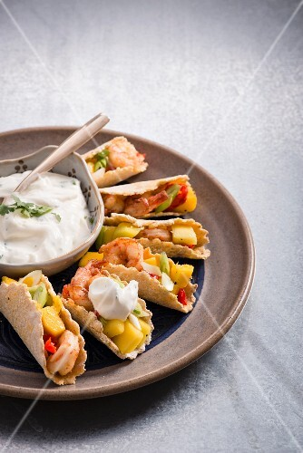 Tacos with prawns, chilli and mango served with coriander yoghurt