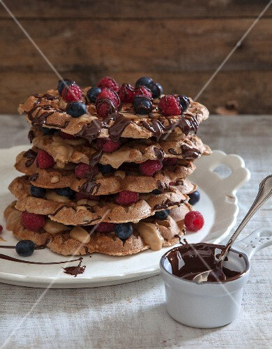 Vegan waffles with fresh berries and chocolate sauce