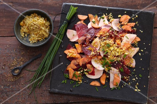 Vegan root vegetable carpaccio with nut crumbs