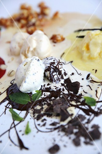 Peppermint ice cream with dark chocolate, pineapple sorbet and vanilla ice cream with macadamia nut brittle