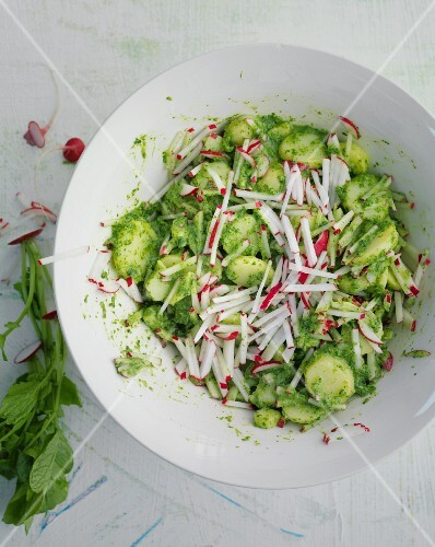 A colourful potato salad with radishes and radish leaves