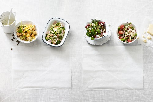Four different low carb salads with cheese