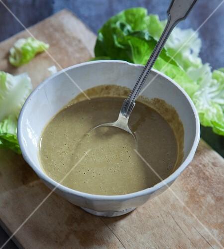 Vegan vinaigrette made from oil, balsamic vinegar, mustard and spring onions