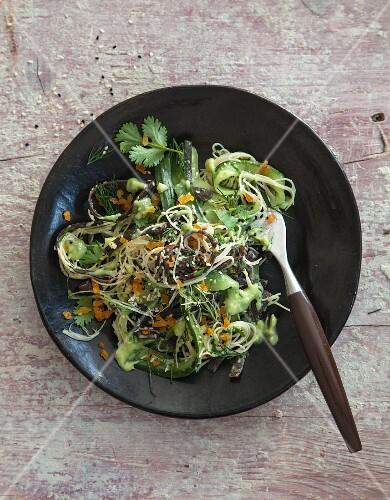 Vegan cucumber and avocado salad with algae pasta