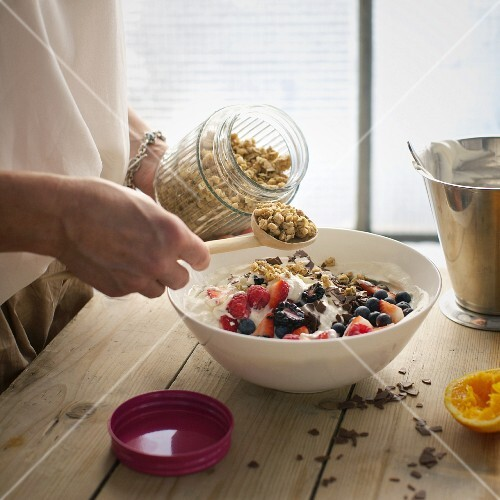 Berry quark with crispy flakes being prepared