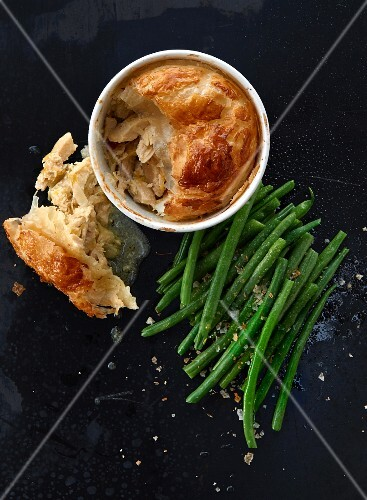 A chicken pie with green beans