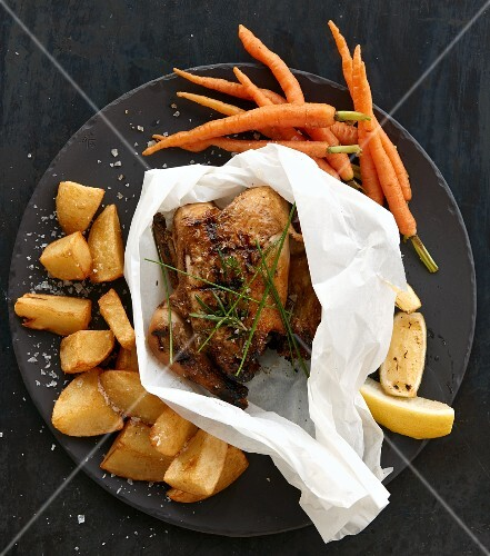 Roast chicken with roast potatoes and carrots