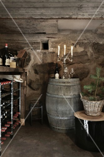 Christmas in a wine cellar: a wine rack and a barrel of wine with a candelabra