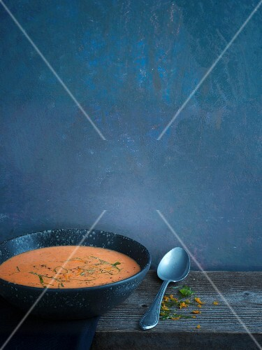 Vegetarian tomato soup with oranges and fresh basil