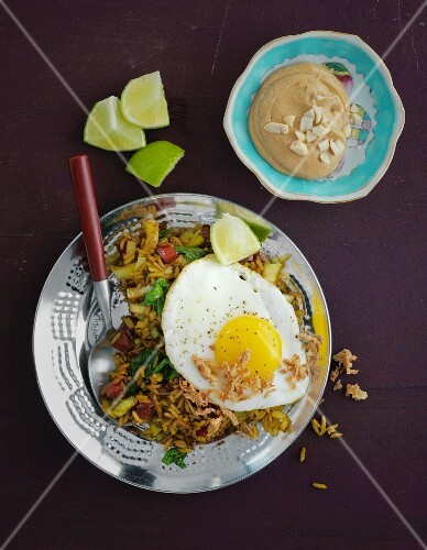 Vegetarian nasi goreng with egg and peanut sauce (Indonesia)