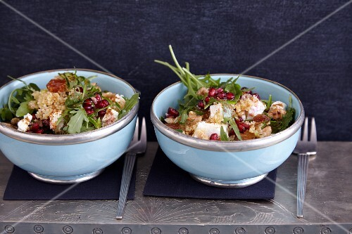 Couscous salad with pomegranate seeds, walnuts and sheep's cheese