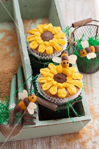 Courgette and almond cupcakes decorated with sunflowers and marzipan bees