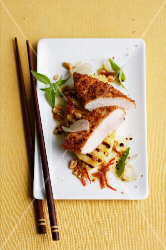 Guinea fowl breast in a coconut coating with grilled mango and a ginger and chilli vinaigrette