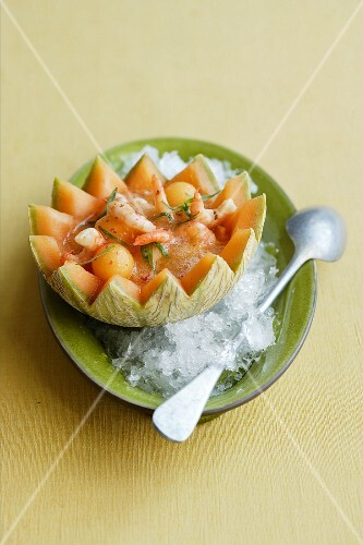 Cold melon and champagne soup with ginger and prawns